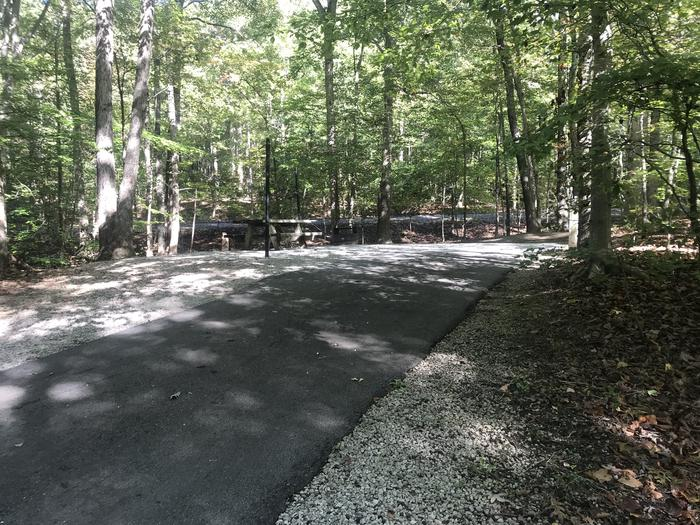 A photo of Site A002 of Loop A at TWIN KNOBS CAMPGROUND with Picnic Table, Electricity Hookup, Fire Pit, Shade, Tent Pad, Lantern Pole