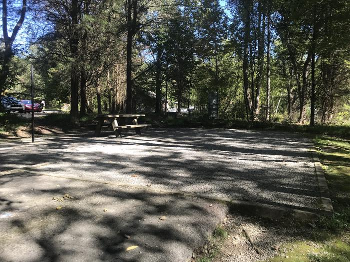A photo of Site A026 of Loop A at TWIN KNOBS CAMPGROUND with Picnic Table, Electricity Hookup, Fire Pit, Shade, Tent Pad, Lantern Pole