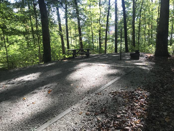 A photo of Site F015 of Loop F at TWIN KNOBS CAMPGROUND with Picnic Table, Fire Pit, Shade, Tent Pad, Lantern Pole