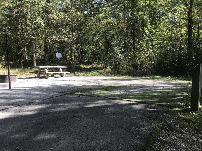 A photo of Site B007 of Loop B at TWIN KNOBS CAMPGROUND with Picnic Table, Electricity Hookup, Fire Pit, Shade, Tent Pad, Lantern Pole