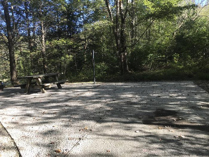 A photo of Site J002 of Loop J at TWIN KNOBS CAMPGROUND with Picnic Table, Electricity Hookup, Fire Pit, Shade, Tent Pad, Lantern Pole