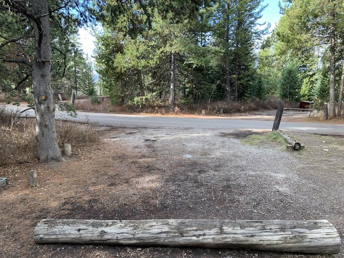 A photo of Site 67 of Loop 3 at Signal Mountain Lodge Campground with Picnic Table, Fire Pit, Shade, Food Storage, Tent Pad