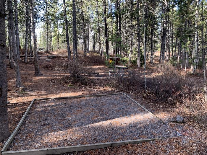 A photo of Site 73 of Loop 3 at Signal Mountain Lodge Campground with Picnic Table, Fire Pit, Shade, Food Storage, Tent Pad