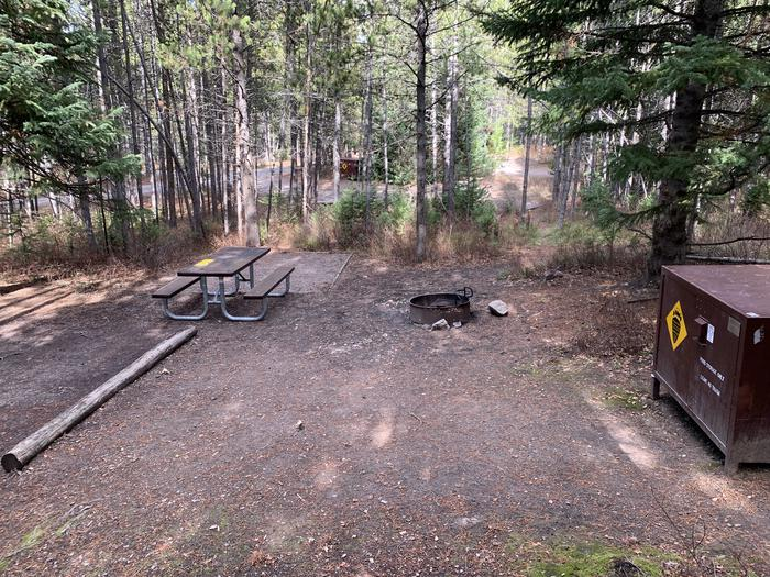 A photo of Site 86 of Loop 3 at Signal Mountain Lodge Campground with Picnic Table, Fire Pit, Shade, Food Storage, Tent Pad