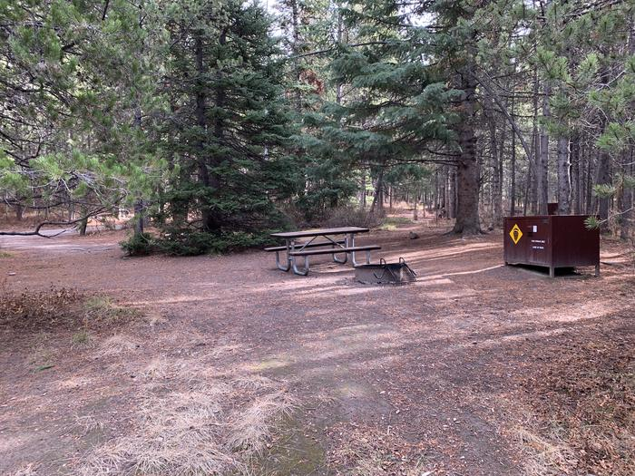 A photo of Site 85 of Loop 3 at Signal Mountain Lodge Campground with Picnic Table, Fire Pit, Shade, Food Storage