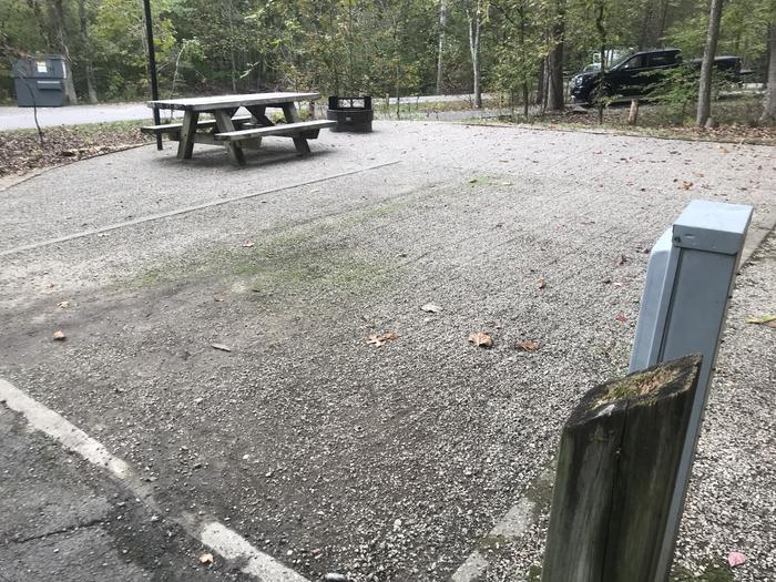 A photo of Site A009 of Loop A at TWIN KNOBS CAMPGROUND with Picnic Table, Electricity Hookup, Fire Pit, Shade, Tent Pad, Lantern Pole