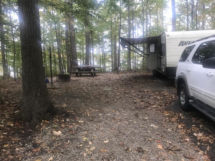 A photo of Site J011 of Loop J at TWIN KNOBS CAMPGROUND with Picnic Table, Electricity Hookup, Fire Pit, Shade, Tent Pad, Waterfront, Lantern Pole