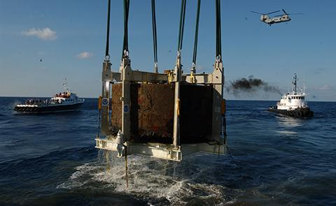 The Monitor's turret breaks the surface of the water for the first time in 140 years.
