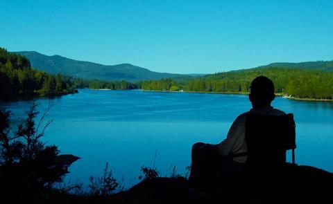 visitor looking at the lake