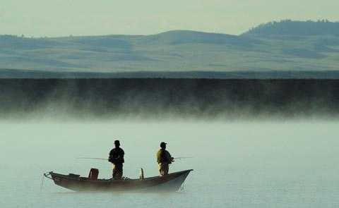 fishing with fog rising off the lakefishing on the lake