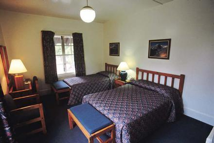 Main Lodge Guest RoomBetween the rustic main lodge and adjacent cabins, families can find the perfect accomodations for their holiday.
