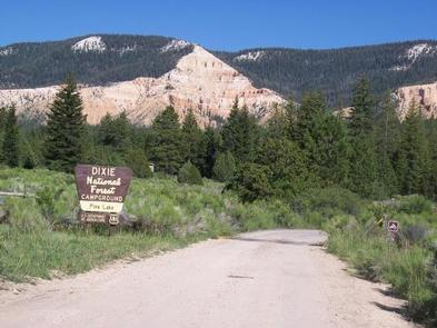 Entrance to PINE LAKE CAMPGROUND with view of adjacent pink cliffs.Campground Entrance