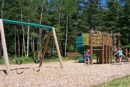Picture of play area.Play area next to the beach and picnic area.  Play area contains swings, slide, and climbing features.