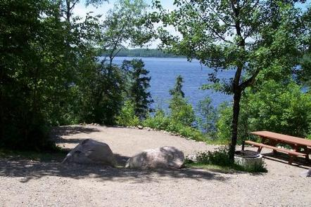 Picture of campsite and lake in the background.Typical campsite on the edge of Fall Lake.  Campsite facilities including tent pads, tables, and firegrates may be accessed via level trails or steps, depending on location of campsite.