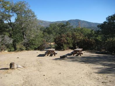 Scenic view of Picnic Tables & Fire Ring at North Shore Campground