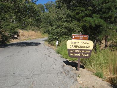 Roadway leading up to North Shore Campground Sign