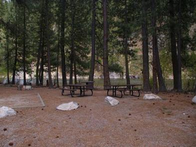 The campsites are nestled amongst the pine trees with picnic tables, tent pads and BBQ stands.Elks Flat Campground