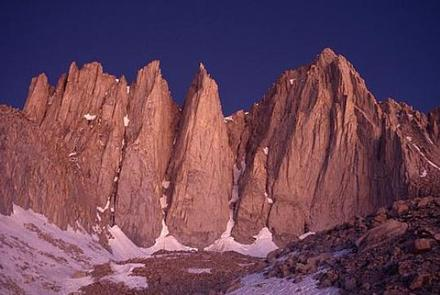Mount WhitneyRosy dawn light illuminates the east face of Mount Whitney