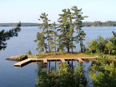 Aerial view of the Kabetogama Lake Group campsite with three large docks overlooking a large, scenic lake.Kabetogama Lake Group Campsite docking facilities