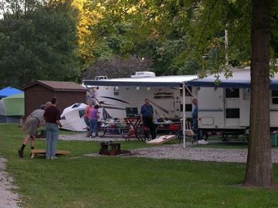 People playing game at their campsite.