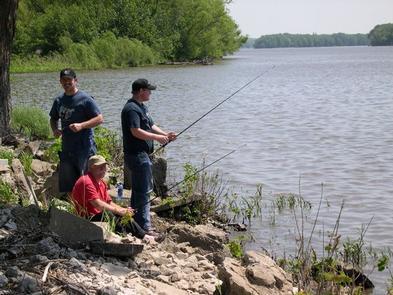 Three men fishing from shoreline.