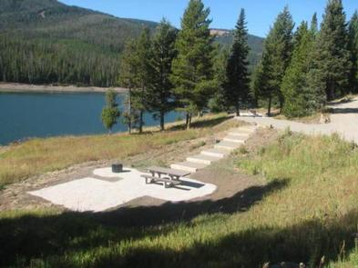 Hood Creek Campground steps down to campsite with view of Hyalite ReservoirCampsite