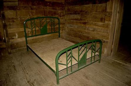 Full size metal bed frame inside cabin
