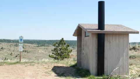 Vault Toilet below the lookout