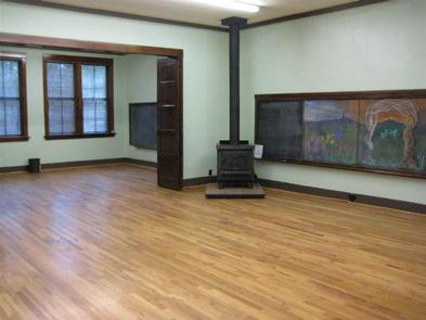 GROOM CREEK SCHOOLHOUSE interior fire place, wooden floors and mural on the right wallInterior of GROOM CREEK SCHOOLHOUSE