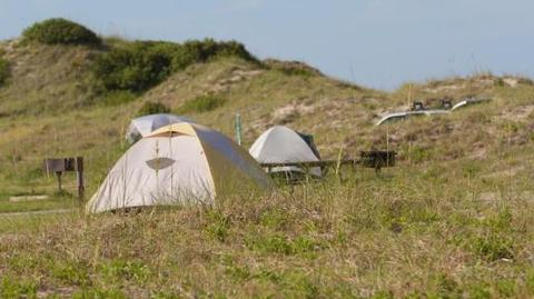 Tents nestled in dunesTents nestled in the dunes