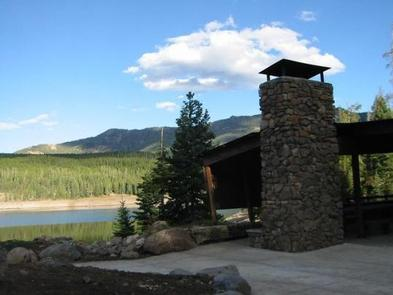 Hyalite Pavilion, fireplace, picnic tables, pine trees, Hyalite Reservoir and mountainsHyalite Pavilion