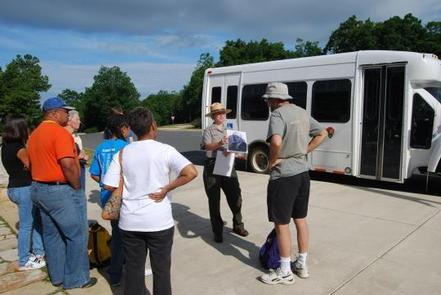 Rapidan Camp Tour bus, with people waiting to boardMeet the ranger at Byrd Visitor Center