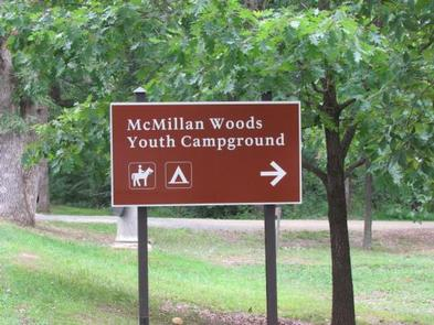 Sign at the entrance to McMillan Woods Campground on West Confederate AvenueEntrance sign