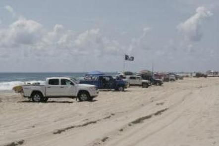 Off-road vehicles enjoying the beachOff-road vehicles parked along the the beach