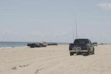 Truck driving along the beachORV route