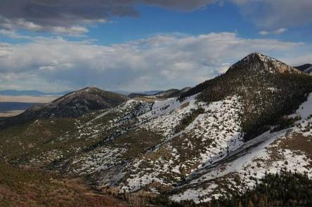 Mountains with patchy snow under blue skyMountains of Great Basin National Park