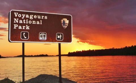Voyageurs National Park sign at sunset