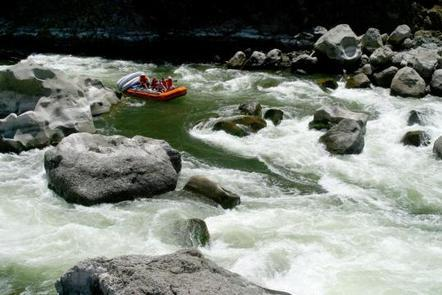 A raft enters Blossom Bar rapid on the Rogue Wild & Scenic River.A rafter entering Blossom Bar rapid.