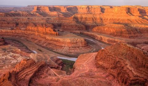 Dead Horse PointIt is 2,000 feet down to the Colorado River. Give your brain time to absorb a scene this immense. The view stretches for more than a hundred miles.