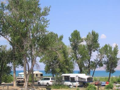 RV and camping on the shores of Bear LakeIf you plan to stay a night or two, camping at Bear Lake State Park is available at the marina, Rendezvous Beach, and Cisco Beach. The Marina and Rendezvous Beach sites have water, flush toilets, and showers, while the Cisco campground is primitive.