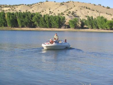 Boating on SteinakerOnce you cast your line into the emerald water you can expect to pull in beautiful rainbow trout. When the water heats up during the summer season, you may even pull in a bass or two.