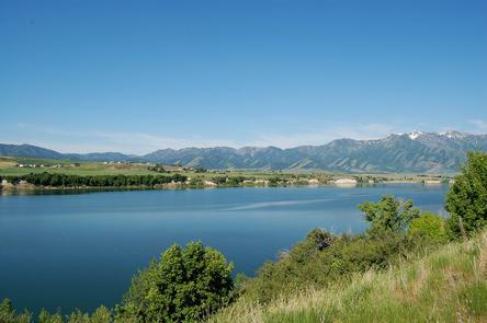Hyrum ReservoirA placid, idyllic lake in the pastoral Cache Valley, Hyrum Reservoir is a perfect retreat for anglers and boaters, or people with good books in need of a quiet beach.