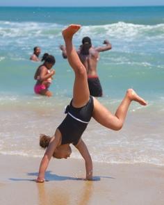 Cartwheel on the BeachGirl enjoys Cape Hatteras by performing a cartwheel.