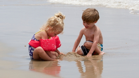Playing in the SandTwo kids enjoy the sands of Cape Hatteras.