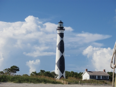 Cape Lookout LighthouseThe Cape Lookout Lighthouse is still an active aid-to-navigation, warning ships of the nearby shoals.  Climbing to up to see the view from the gallery level, 14 stories above the ground, is also a popular activity by visitors during the summer.