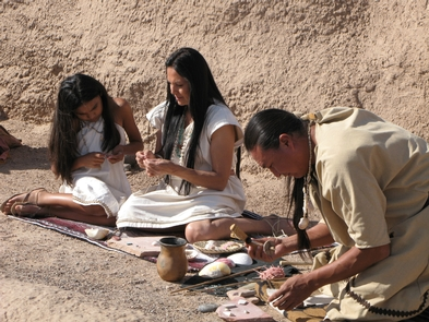 Actors Recreating JewelryIn this scene from the park movie, actors demonstrate jewelry making as done in ancestral times.