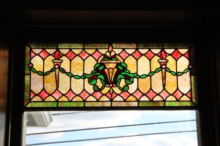 Stained Glass TransomThe colorful stained glass transom above the main entrance door to Youngsholm