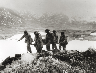 The battle for Attu IslandU.S. wounded are gathered from the battlefield on Attu Island.  The battle on Attu, lasting nearly 20 days, was the second most deadly in the Pacific Theater.
