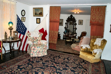 Front ParlorFront Parlor, Clara Barton's favorite chair in front of flags.