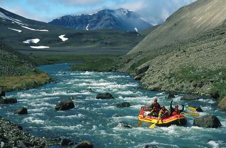 "Floating the Gates of AniakchakA lone raft floats the Aniakchak Wild River as it flows through the ""Gates"""